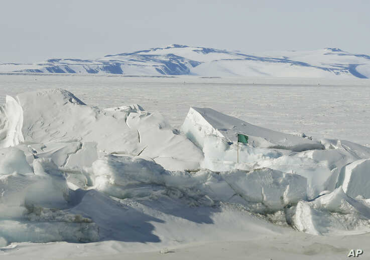 A frozen section of the Ross Sea at the Scott Base is pictured in Antarctica Saturday, Nov. 12, 2016. U.S. Secretary of State…