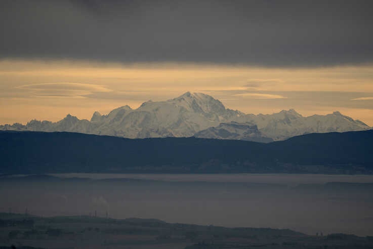 The Mont Blanc is seen behind the foggy plains around Lyon, central France, Tuesday, Nov. 26, 2019. (AP Photo/Laurent Cipriani)