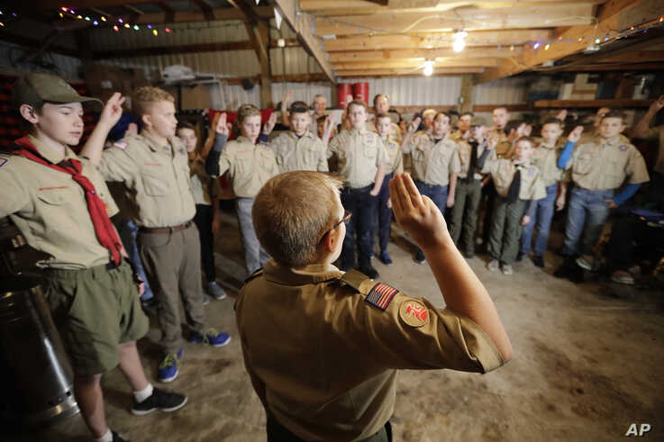 In this Thursday, Dec. 12, 2019 photo, a Boy Scouts troop gathers during their meeting, in Kaysville, Utah. For decades, The…