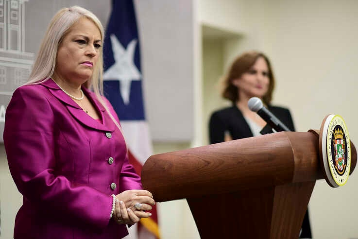 FILE - In this Aug. 21, 2019 file photo, Puerto Rico's Governor Wanda Vazquez holds a press conference to announce new…