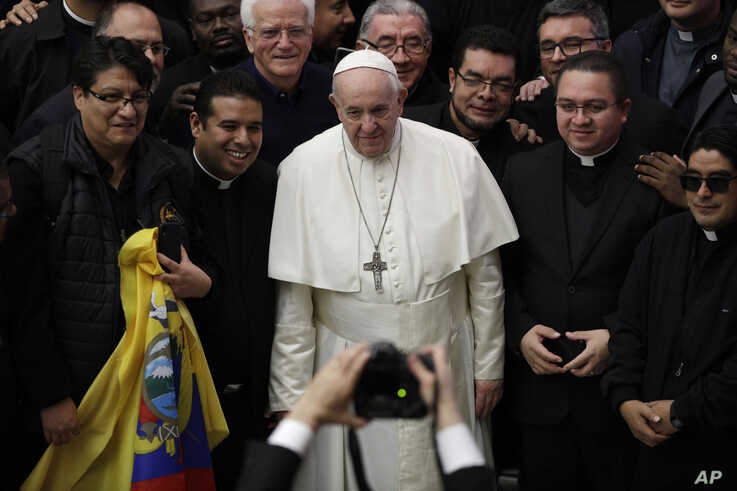 Pope Francis poses for a picture with priests during the weekly general audience at the Vatican, Wednesday, Feb. 12, 2020. (AP…