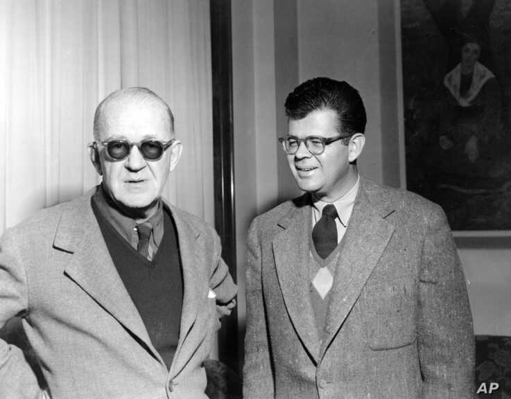 "Film director John Ford, left, and his son Patrick are seen at  their hotel in Rome on Feb. 2, 1953.  John Ford, director  ""The…"