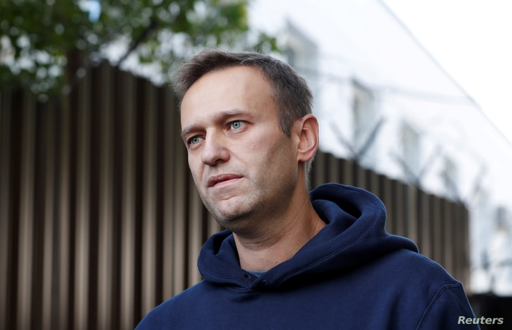 FILE PHOTO: Russian opposition leader Alexei Navalny speaks with journalists after he was released from a detention centre in…