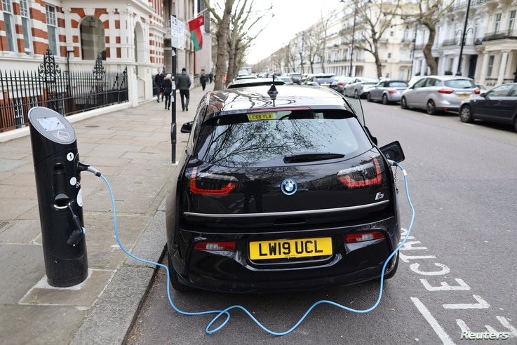 Electric car charges on a street in London, Britain, February 4, 2020. REUTERS/Antonio Bronic
