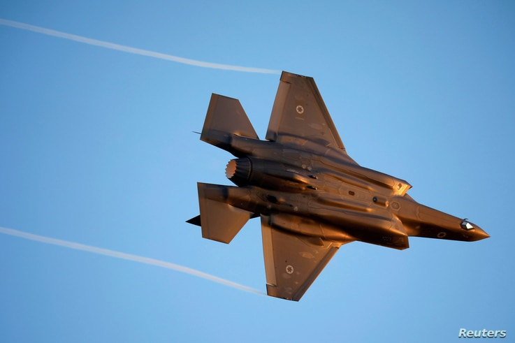 FILE PHOTO: Israeli Air Force F-35 flies during an aerial demonstration at a graduation ceremony for Israeli air force pilots…