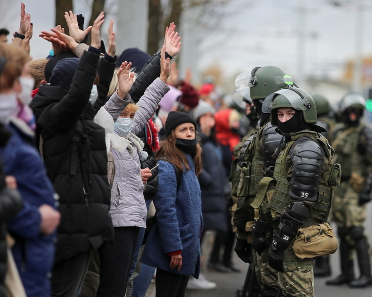 Belarusian law enforcement officers block opposition supporters during their rally to reject the presidential election results…