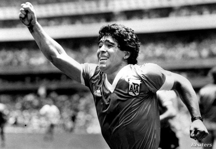 FILE PHOTO:  Argentinian star Diego Maradona raises his arm in the air after scoring his game winning goal against England in…