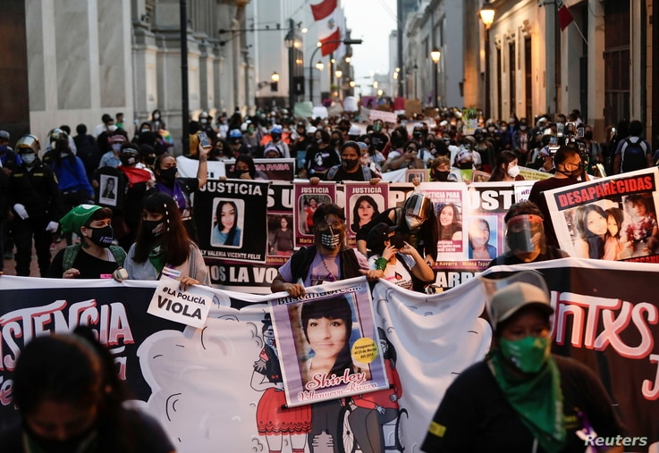Demonstrators march during a protest to mark the International Day for the Elimination of Violence against Women, in Lima, Peru…