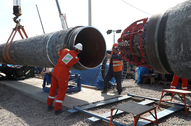 FILE PHOTO: Workers are seen at theconstruction siteof the NordStream2 gas pipeline, near the town of Kingisepp, Leningrad…