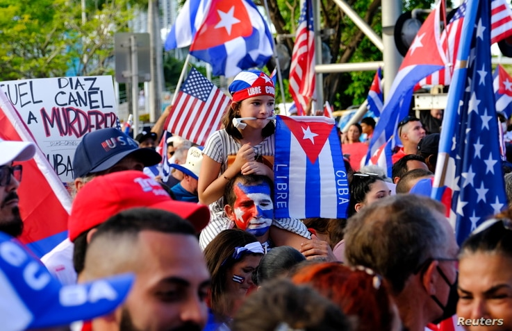 Emigres react to reports of protests in Cuba against its deteriorating economy, in Miami, Florida, U.S. July 17, 2021.  …