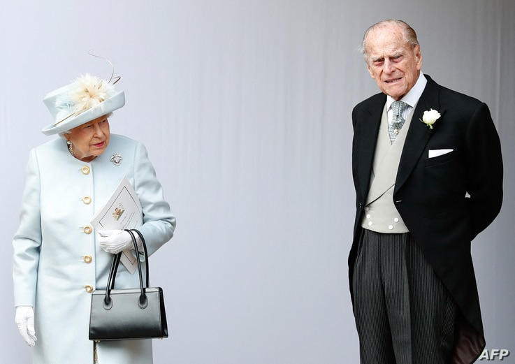 (FILES) In this file photo taken on October 12, 2018 Britain's Queen Elizabeth II (L) and Britain's Prince Philip, Duke of…