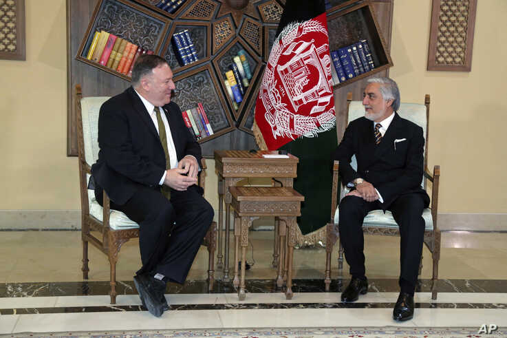 U.S. Secretary of State Mike Pompeo, left, meets with Abdullah Abdullah the main political rival of President Ashraf Ghani at…