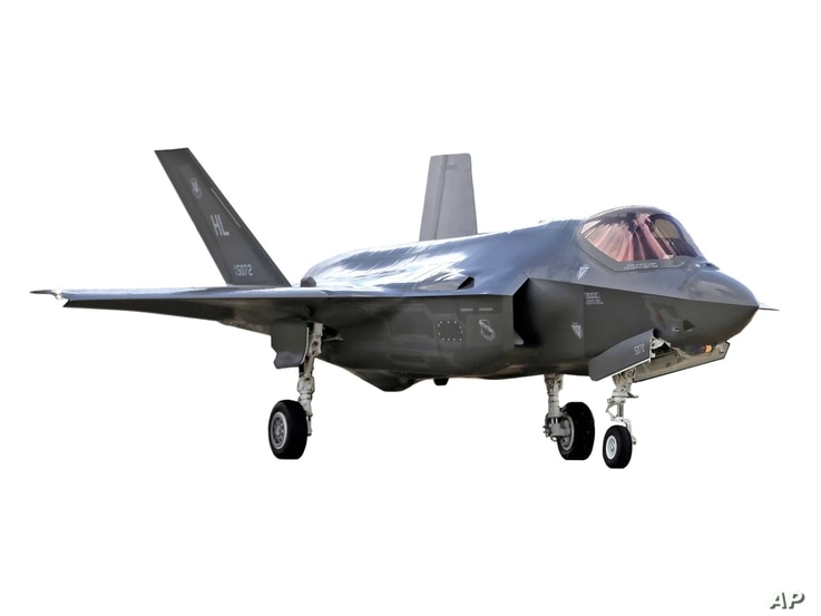 US Air Force F-35 jet on the tarmac at Hill Air Force Base, Utah, graphic element on white