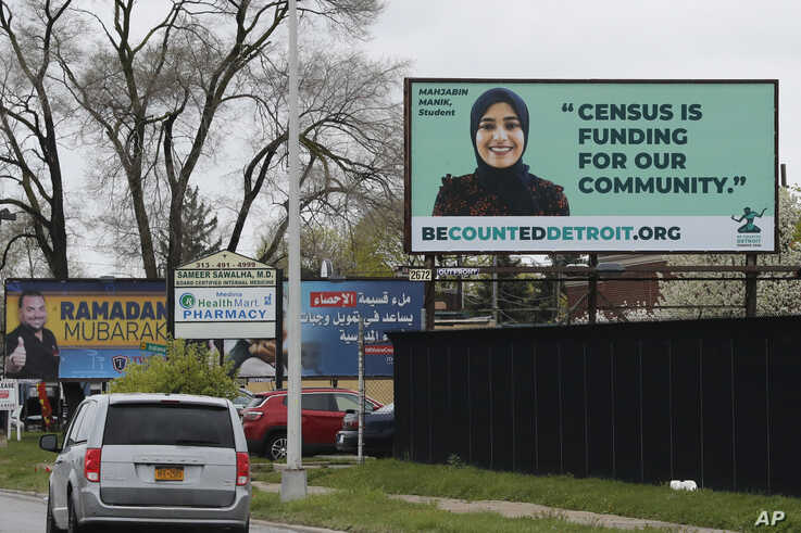 In this Thursday, April 30, 2020 photo, a billboard highlighting the 2020 Census is seen in Dearborn, Mich. The Arab American…