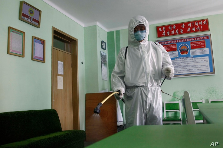 The offices of the Phyongchon District People's Hospital are disinfected to help prevent the spread of the coronavirus on…