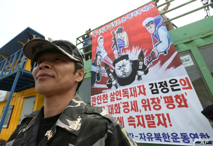 A North Korean defector stands during a press conference to send anti-North Korea propaganda balloons to North Korea, in Paju,…