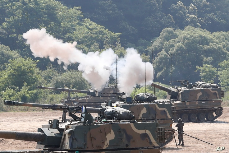 A South Korean army K-9 self-propelled howitzer fires during the annual exercise in Paju, South Korea, near the border with…