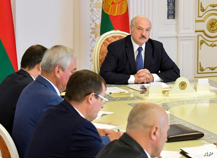 Belarusian President Alexander Lukashenko chairs a Security Council meeting in Minsk, Belarus, Tuesday, Aug. 18, 2020. The…