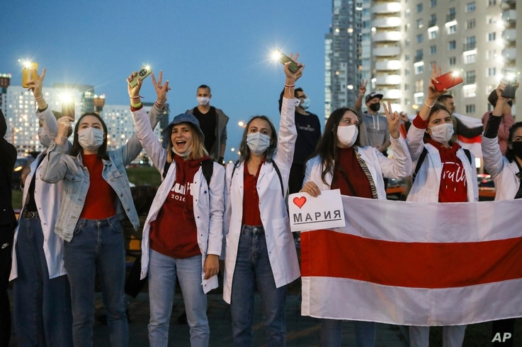 Belarusian medical workers gesture during a rally in support of Maria Kolesnikova, and other members of the Coordination…