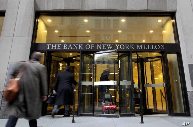 FILE - In this April 20, 2009 file photo, people enter the Bank of New York building in New York's Financial District.  Bank of…