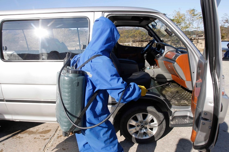 Hygienic and anti-epidemic officials disinfect vehicles coming into the city of Wonsan, Kangwon Province, North Korea DPRK, on…