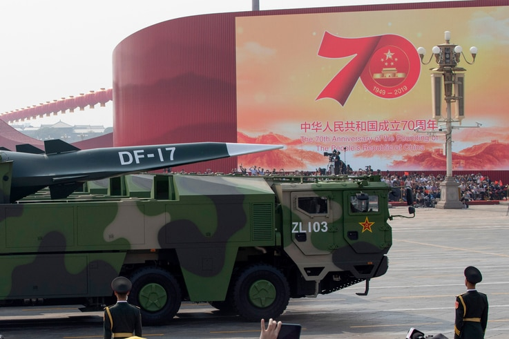Chinese military vehicles carrying DF-17 roll during a parade to commemorate the 70th anniversary of the founding of Communist…