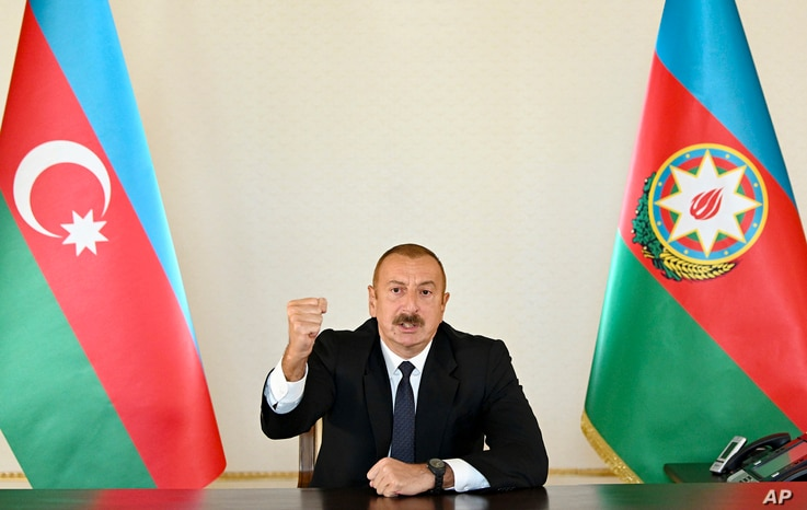 In this photo provided by the Azerbaijan's Presidential Press Office provided on Sunday, Sept. 27, 2020, Azerbaijani President…