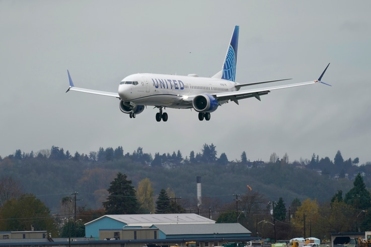 A Boeing 737 Max 9 built for United Airlines lands at King County International Airport - Boeing Field after a test flight from…