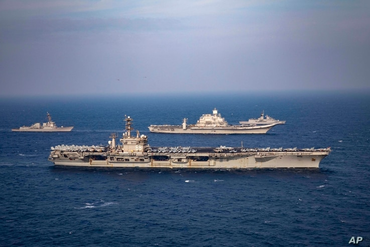 Aircraft carriers and warships participate in the second phase of Malabar naval exercise, a joint exercise comprising of India,…