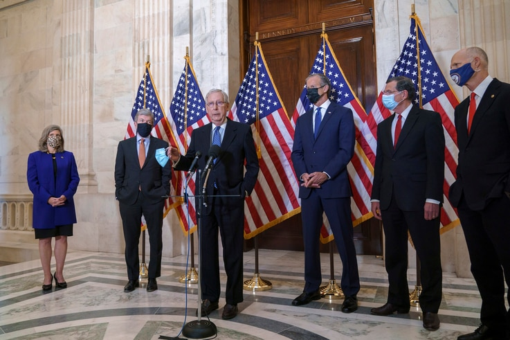 Senate Majority Leader Mitch McConnell, R-Ky., talks briefly to reporters after the Republican Conference held leadership…