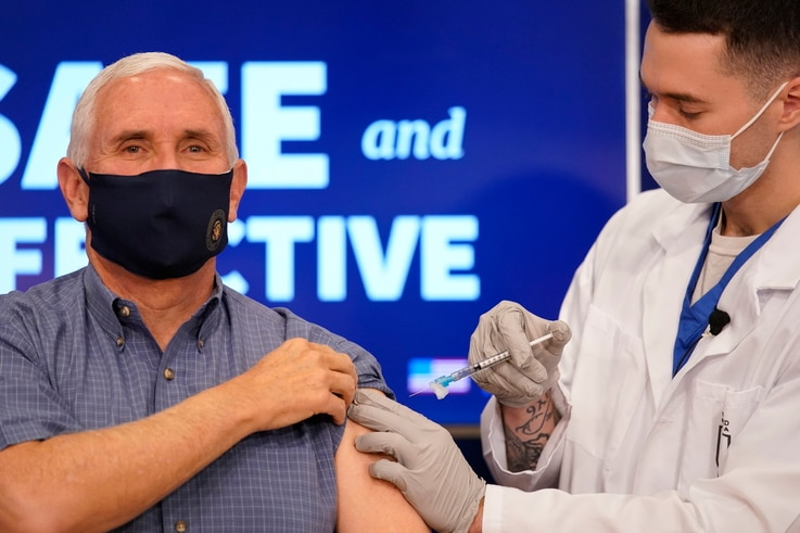 Vice President Mike Pence receives a Pfizer-BioNTech COVID-19 vaccine shot at the Eisenhower Executive Office Building on the…