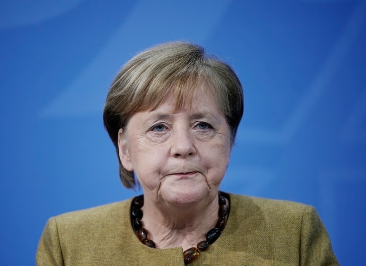 Germany's Chancellor Angela Merkel takes part in a press conference following the consultations between the federal and state…