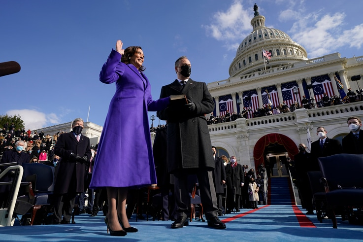 Kamala Harris is sworn in as Vice President by Supreme Court Justice Sonia Sotomayor as her husband Doug Emhoff holds the Bible…