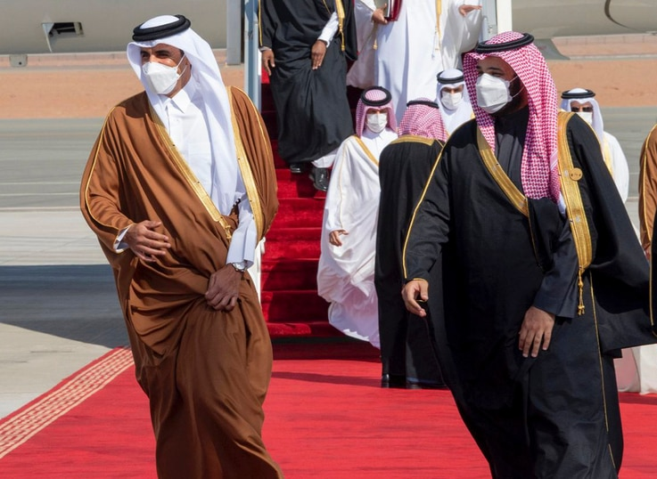 In this photo provided by the Saudi Royal Court, Saudi Arabia's Crown Prince Mohammed bin Salman, right, welcomes Qatar's Emir…