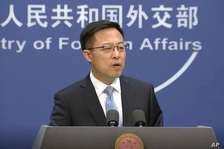 In this image from video, Chinese Foreign Ministry spokesperson Zhao Lijian speaks at a briefing in Beijing Tuesday, Nov. 17,…