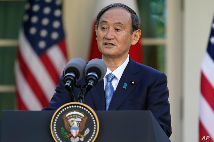 Japanese Prime Minister Yoshihide Suga, speaks at a news conference with President Joe Biden in the Rose Garden of the White…