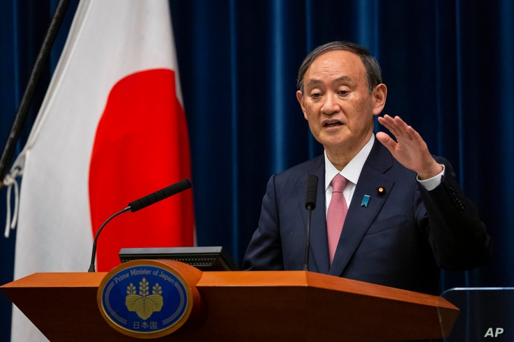 Japanese Prime Minister Yoshihide Suga speaks during a press conference at the prime minister's official residence on Friday,…
