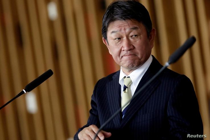 FILE PHOTO: Japan's Foreign Minister Toshimitsu Motegi looks on during a statement to the media in Brasilia