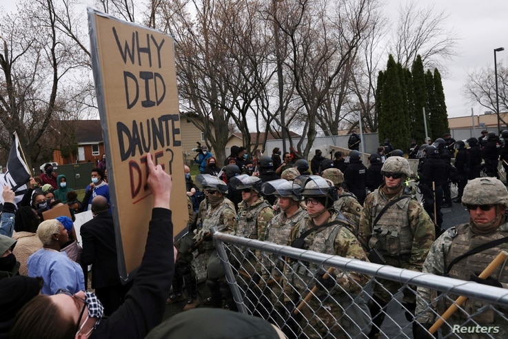 Protesters rally outside Brooklyn Center Police Department a day after Daunte Wright was shot and killed by a police officer, in Brooklyn Center, Minnesota