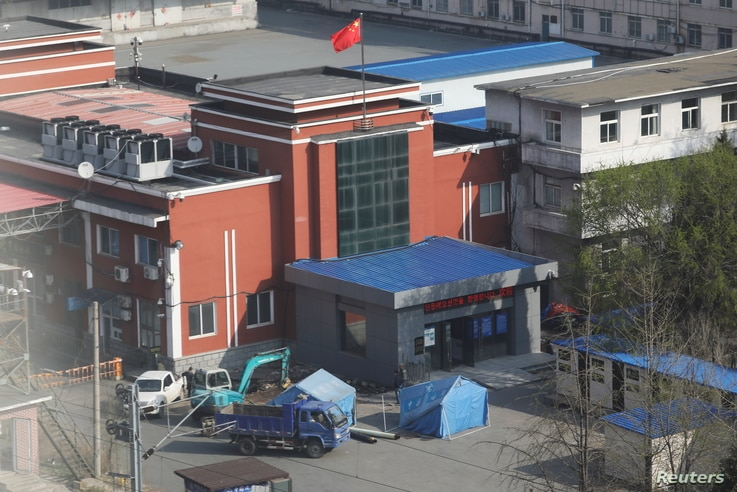 Workers stand near tents inside the Chinese customs office in Dandong