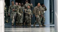 U.S. Army personnel are seen at the Jacob K. Javits Convention Center, which will be partially converted into a hospital for…