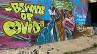 A mural warns residents of the danger of coronavirus disease (COVID-19) outbreak on the Navajo reservation, in Shiprock, New…