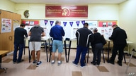 People cast their ballots in voting booths at the 2nd Street Elementary School in the Boyle Heights neighborhood of Los Angeles…