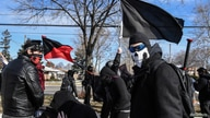 Members of the Great Lakes anti-fascist organization (Antifa) protest against the Alt-right outside a hotel in Warren, Michigan…