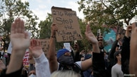 Demonstrators raise their arms during a protest against the death of African-American man George Floyd under Minneapolis police…