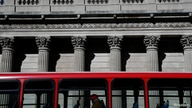 FILE PHOTO: A quiet bus passes the Bank of England, as the spread of the coronavirus disease (COVID-19) continues, in London,…