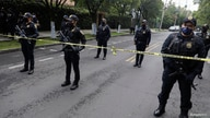 Police officers keep watch near a crime scene following an assassination attempt of Mexico City's chief of police Omar Garcia…