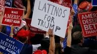 A person holds a sign reading 'Latinos for Trump' on the Republican National Convention
