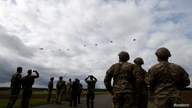 Paratroopers jump off planes as they take part in an exercise of the U.S. Army's Global Swift Response 17 Media Day near…