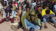 Migrants are seen after being intercepted by Libya's GNA iInterior Ministry before attempting a journey to Europe, at a…